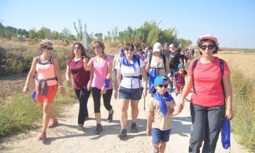 Más de quinientas personas marchan de Cofita a Fonz por la realización del albergue La Sabina de Down Huesca