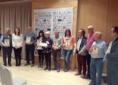 La generación del 57 entrega a Down Huesca 2.000 euros del concierto de Karina y Los Diablos